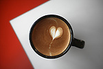 An artist presentation of a part designed on top of a cappuccino made at a café in Sausalito, California.