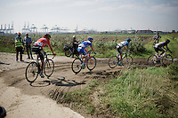 As soon as they leave the Antwerp Harbour, the first 'cobbled' section is actually a very slippery mud section where motorbikes get stuck or crash and chaos sets in... this won't really get any different for the entire race.<br /> <br /> 90th Schaal Sels 2015