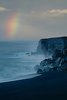 Rainbow over black sand beach<br />