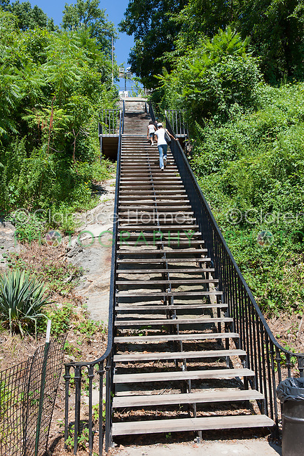 People climb the stairs leading from the High Bridge up to Highbridge Park in Washington Heights in New York City.