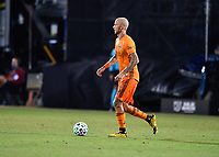 LAKE BUENA VISTA, FL - JULY 18: Aljaz Struna #5 of the Houston Dynamo looks for options as he carries the ball during a game between Houston Dynamo and Portland Timbers at ESPN Wide World of Sports on July 18, 2020 in Lake Buena Vista, Florida.