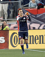 New England Revolution midfielder Diego Fagundez (14) celebrates his goal and acknowledges Kevin Alston.In a Major League Soccer (MLS) match, the New England Revolution (blue/red) defeated Philadelphia Union (blue/white), 2-0, at Gillette Stadium on April 27, 2013.