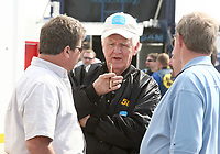 72-year-old NASCAR driver James Hylton, talsk with members of his crew at before Daytona 500 qualifying at daytona International Speedway on Sunday, February 11,  2007.  (Photo by Brian Cleary/www.bcpix.com)