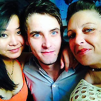 """Pictured: Jordan Matthews (C) with girlfriend Xixi Bi (L), image taken from open social media site<br /> Re: A man called 999 after allegedly beating his girlfriend to death saying he had been """"really, really horrible"""" to her, a court heard.<br /> Jordan Matthews, of Ely Road, Cardiff, is accused of murdering his girlfriend of 16 months, Xixi Bi.<br /> Cardiff Crown Court heard Miss Bi, 24, had a broken jaw, ribs and widespread bruising following the attack in August 2016.<br /> Mr Matthews, 24, admits manslaughter but denies murder.<br /> Paul Lewis, QC, prosecuting, said it was a """"vicious, sustained and prolonged attack"""".<br /> A 999 call made by Mr Matthews at 08:00 GMT on 19 August 2016 was played in court, in which he said the pair had bickered the night before and he had hit her.<br /> He told the operator he had been """"really, really horrible"""" to Miss Bi and she was now struggling to breathe, that he had done CPR on her and she was responding."""
