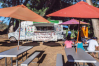People eating at Giovanni's famous shrimp truck in Haleiwa, O'ahu.