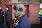 Motherwell 3 Dundee 1, 12/12/2015. Fir Park, Scottish Premiership. A man wearing a hat and a striped scarf waiting for friends outside the Phil O'Donnell Stand at Fir Park, home to Motherwell Football Club, before they played Dundee in a Scottish Premiership fixture. Formed in 1886, the  home side has played at Fir Park since 1895. Motherwell won the match by three goals to one, watched by a crowd of 3512 spectators. Photo by Colin McPherson.
