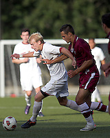 Boston College midfielder Kyle Bekker (10) dribbles as Harvard University forward Michael Innocenzi (2) defends. Boston College defeated Harvard University, 2-0, at Newton Campus Field, October 11, 2011.