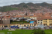 Peru, Cusco.  Cusco Growing up the Hillsides.   View of the City from Santo Domingo Monastery, built on and around Qorikancha, Inca Temple of the Sun.