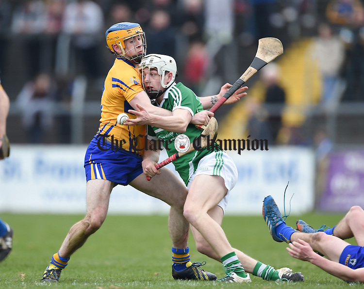 Oisin O Brien of Clare in action against David Reidy of Limerick during their Div. 1b Round 5 game in Cusack park. Photograph by John Kelly.