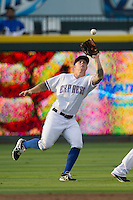 Round Rock Express outfielder Aaron Cunningham (3) makes a running catch during the Pacific Coast League baseball game against the New Orleans Zephyrs on June 30, 2013 at the Dell Diamond in Round Rock, Texas. Round Rock defeated New Orleans 5-1. (Andrew Woolley/Four Seam Images)