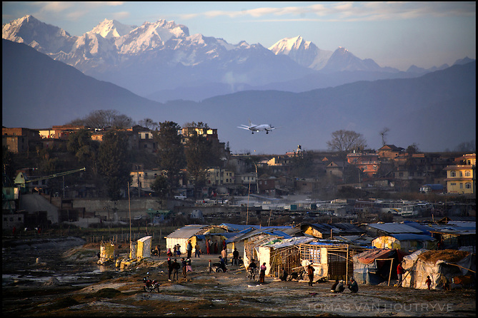 Half constructed slum housing for recent migrants to from rural areas is seen near the airport on the outskirts of Kathmandu, on 7 January, 2006. The decade long conflict between Maoists and the Hindu monarchy has driven thousands of people out of the rural areas and into the city.<br />