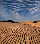 Photoshop composite. Great Sand Dunes National Park, Alamosa, Colorado. John offers private photo tours to Great Sand Dunes National Park and Rocky Mountain National Park, Colorado.