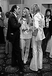 Father of bride, Caxton Hall Westminster London. London's main register office until 1979. White wedding his and her uni sex clothes trouser suits flares or bell bottoms and cuban healed shoes. Long hair. 1970s fashionable London ..<br /> He is Michael Stephens I think a well know hairdresser of the time. If you know otherwise please let me know.