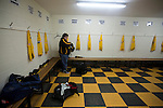 Belper Town v Gresley, 28/01/2014. Christchurch meadow, Northern Premier League. The home club's kit man laying out strips in the dressing room before Belper Town's match against Gresley, in a Northern Premier League, first division south fixture at Christchurch meadow. The home side have played at their current ground since the club was reformed in 1951. Belper won this fixture against their local Derbyshire rivals by 4 goals to 1 watched by a crowd of 165 spectators. Photo by Colin McPherson.