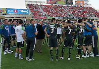 The Seattle Sounders FC team huddle during an MLS game between the Seattle Sounders FC and the Toronto FC at BMO Field in Toronto on June 18, 2011..The Seattle Sounders FC won 1-0.
