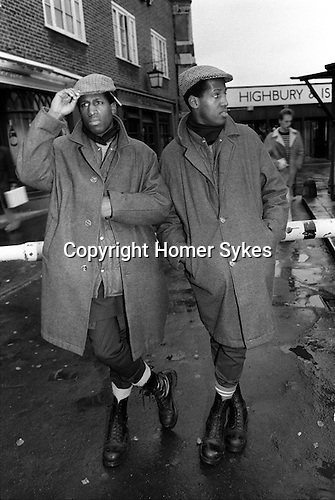 Chuka and Dubem Okonkwo who became known as Chet and Joe Okonkwo, also know as  The Islington Twins,  at the 'outside Highbury and Islington tube station London UK 1984