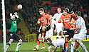 :: DUNDEE UTD'S BARRY DOUGLAS (RIGHT) HEADS HOME UNITED'S FIRST ::