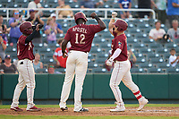 Frisco RoughRiders Steele Walker (2) celebrates with Sherten Apostel (12) and J.P. Martinez (1) after hitting a home run during a game against the San Antonio Missions on June 25, 2021 at Dr. Pepper Ballpark in Frisco, Texas.  (Ken Murphy/Four Seam Images)