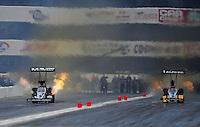Nov. 12, 2011; Pomona, CA, USA; NHRA top fuel dragster driver Dom Lagana (left) races alongside Mike Ashley during qualifying at the Auto Club Finals at Auto Club Raceway at Pomona. Mandatory Credit: Mark J. Rebilas-.