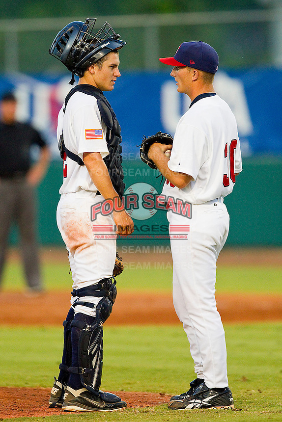 Catcher Chris Okey #2 of the USA 18u National Team chats with relief pitcher Matthew Crownover #30 at the USA Baseball National Training Center on July 2, 2011 in Cary, North Carolina.  The College National Team defeated the 18u team 8-1.  Brian Westerholt / Four Seam Images
