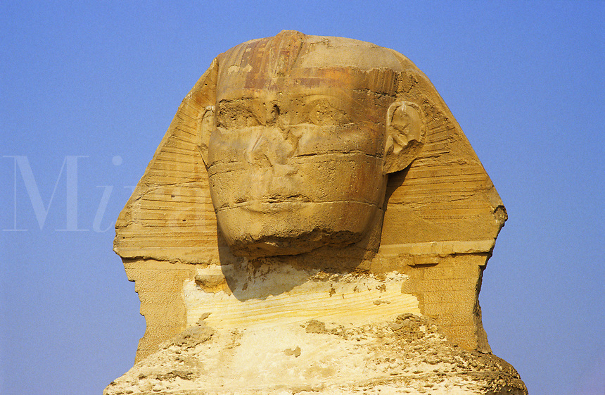 Head of the Sphinx at Giza, near Cairo, Egypt.  The head represents the Pharaoh and the monument was built by Khephren or Khafre about 2620 BC.  The head is seriously eroded and has been unskilfully patched. .