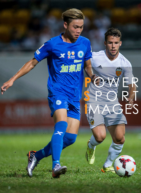 (R) Juan Bernat of Valencia CF competes for the ball with (L) You Kwok Chuck of BC Ranger FC during LFP World Challenge 2014 between Valencia CF vs BC Rangers FC on May 28, 2014 at the Mongkok Stadium in Hong Kong, China. Photo by Victor Fraile / Power Sport Images