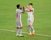 WASHINGTON, DC - SEPTEMBER 12: Cristian Casseres Jr. #23 and Ben Mines #17 of the New York Red Bulls celebrate during a game between New York Red Bulls and D.C. United at Audi Field on September 12, 2020 in Washington, DC.