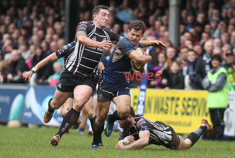 Leinster A wing Sam Coghlan-Murray looks over his shoulder as Pontypridd centre Dafydd Lockyer closes in.<br /> British & Irish Cup Semi Final<br /> Pontypridd v Leinster A<br /> Sardis Road - Pontypridd<br /> <br /> ©Steve Pope-SPORTINGWALES