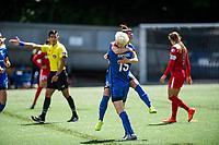 Seattle, WA - Saturday May 13, 2017: Megan Rapinoe and Nahomi Kawasumi during a regular season National Women's Soccer League (NWSL) match between the Seattle Reign FC and the Washington Spirit at Memorial Stadium.