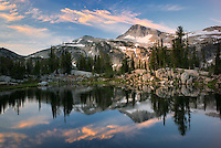 Evening light and reflection in Sunshine Lake with Eagle Cap Mountain. Eagle Cap Wilderness, Oregon