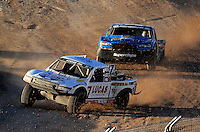 Nov. 6, 2010; Las Vegas, NV USA; LOORRS pro two unlimited driver Carl Renezeder (17) leads Robby Woods during round 13 at the Las Vegas Motor Speedway short course. Mandatory Credit: Mark J. Rebilas-