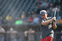 A young fan breaks a water balloon with a baseball bat between innings of the South Atlantic League game between the Rome Braves and the Columbia Fireflies on Sunday, July 2, 2017, at Spirit Communications Park in Columbia, South Carolina. Columbia won, 3-2. (Tom Priddy/Four Seam Images)