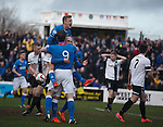Nicky Law mobbed by Dean Shiels and Jon Daly after scoring
