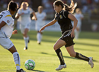 Tina DiMartino (right) runs the ball past Sharlota Nonen (left). LA Sol and FC Gold Pride tied 0-0 at Buck Shaw Stadium in Santa Clara, California on July 23, 2009.