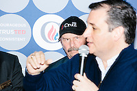 NH State Representative Rick Christie (R-Goffstown) look on as Texas senator and Republican presidential candidate Ted Cruz speaks at The Village Trestle restaurant in Goffstown, New Hampshire, on Wed., Feb. 3, 2016.