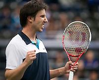 14-02-12, Netherlands,Tennis, Rotterdam, ABNAMRO WTT, Igor Sijsling  viert feest hij wint de tweede set van Nieminnen