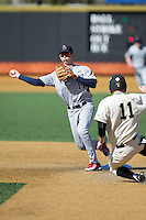Tyler Beckwith (17) of the Richmond Spiders makes a throw to first base to complete a double play against the Wake Forest Demon Deacons at David F. Couch Ballpark on March 6, 2016 in Winston-Salem, North Carolina.  The Demon Deacons defeated the Spiders 17-4.  (Brian Westerholt/Four Seam Images)