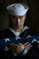 130513-N-DR144-972 PACIFIC OCEAN (May 13, 2013)- Damage Controlman 3rd Class Jason Tajima bears the flag during a burial at sea aboard San Antonio-class amphibious transport dock ship USS Anchorage (LPD 23).  Anchorage is underway after being commissioned in its namesake city of Anchorage, Alaska. (U.S. Navy photo by Mass Communication Specialist 1st Class James R. Evans / RELEASED)