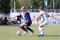 CARY, NC - SEPTEMBER 12: Amy Rodriguez #12 of the North Carolina Courage is defended by Meghan Klingenberg #25 of the Portland Thorns FC during a game between Portland Thorns FC and North Carolina Courage at Sahlen's Stadium at WakeMed Soccer Park on September 12, 2021 in Cary, North Carolina.