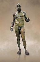 Full length face on view of the Riace bronze Greek statue B cast about 460 - 450 BC. statue B was probably sculpted by Phidias. There is a sense of movement in the statues their legs being bent as if they are about to take a step. Their heads are turned which accentuates a sense of anticipation as if they are looking for something. The anatomical detail is extraordinary which gives a startling realism to the statue and demonstarte the high level of skill of the Greek sculptors of this peiod. Museo Nazionale della Magna Grecia,  Reggio Calabria, Italy.