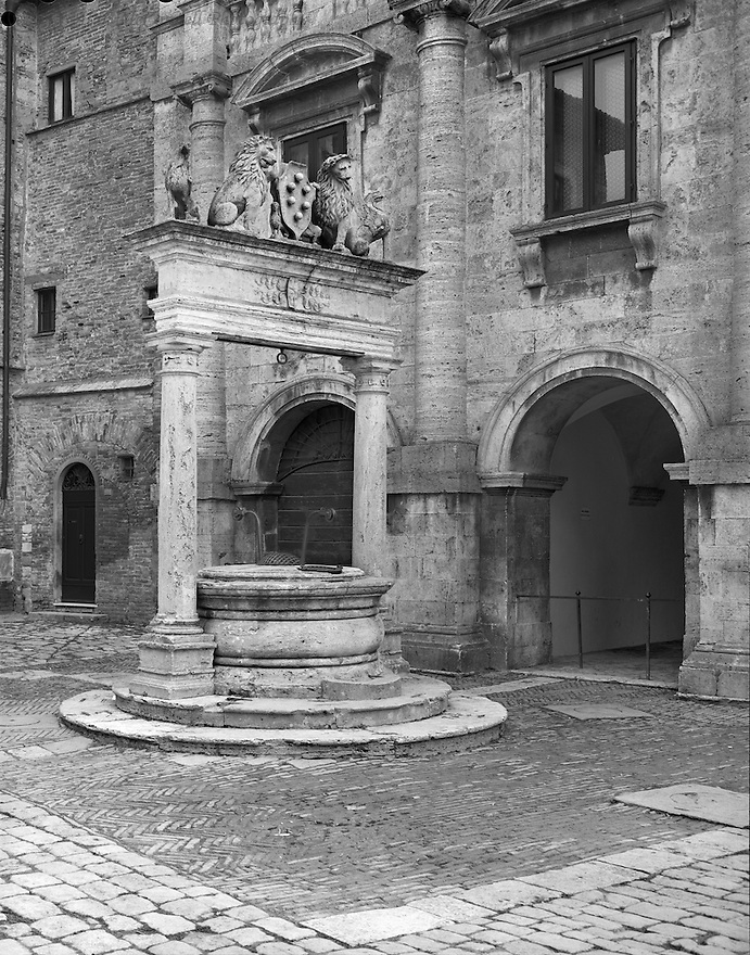 """""""Lifeblood of the Town""""<br /> Montepulciano, Italy<br /> 2015<br /> <br /> For a walled, hilltop, medieval town to survive, the community cistern was a vital resource.  Montepulciano's cistern, with the Medici crest, can be found next to the main piazza.<br /> <br /> 4 x 5 Large Format Film"""