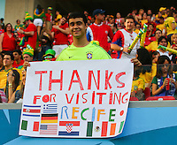 A supporter holds up a poster saying 'Thanks for visiting Recife'