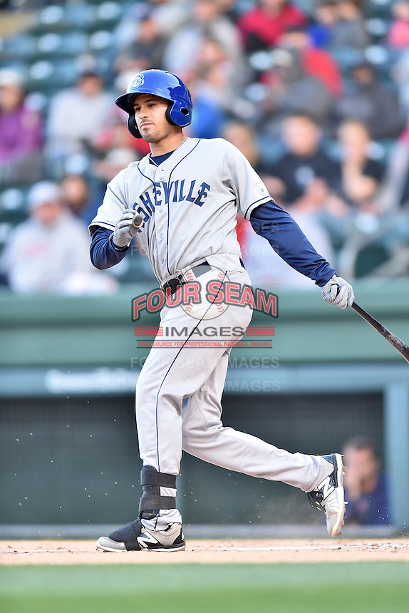Asheville Tourists designated hitter Josh Fuentes (19) swings at a pitch during a game against the Greenville Drive at Fluor Field on April 7, 2016 in Greenville South Carolina. The Drive defeated the Tourists 4-3. (Tony Farlow/Four Seam Images)