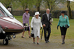 Merthyr Tydfil - UK - 26th April 2012 : The Queen and the Duke of Edinburgh arriving by helicopter during a visit to Cyfarthfa Castle museum and art gallery in Merthyr Tydfil this afternoon.  The Queen and Prince Philip are visiting towns and cities all over the United Kingdom to mark the Diamond Jubilee year.