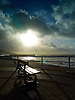 Public Bench on Aberystwyth Promenade after the storms that struck the South of England and Wales end of 2013 with monster waves causing damage and floods.<br /> <br /> Stock Photo by Paddy Bergin