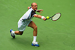 SHANGHAI, CHINA - OCTOBER 15:  Nikolay Davydenko of Russia returns a shot to Fernando Gonzalez of Chile during day five of 2009 Shanghai ATP Masters 1000 at Qi Zhong Tennis Centre on October 15, 2009 in Shanghai, China.  Photo by Victor Fraile / The Power of Sport Images