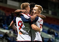 Bolton Wanderers' Eoin Doyle (left) celebrates scoring his side's first goal with team mate Ali Crawford  <br /> <br /> Photographer Andrew Kearns/CameraSport<br /> <br /> The EFL Sky Bet League Two - Bolton Wanderers v Salford City - Friday 13th November 2020 - University of Bolton Stadium - Bolton<br /> <br /> World Copyright © 2020 CameraSport. All rights reserved. 43 Linden Ave. Countesthorpe. Leicester. England. LE8 5PG - Tel: +44 (0) 116 277 4147 - admin@camerasport.com - www.camerasport.com