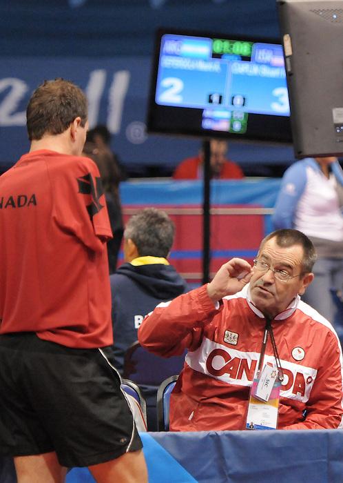 Martin Pelletier, Guadalajara 2011 - Para Table Tennis // Paratennis de table.<br /> Martin Pelletier receiving instructions from his coach John MacPherson // Martin Pelletier recevant les instructions de son entraîneur John MacPherson. 11/14/2011.