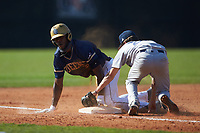 Broadus Roberson (39) of the Queens Royals steals third base ahead of the tag by Levi Perrell (22) of the Catawba Indians during game two of a double-header at Tuckaseegee Dream Fields on March 26, 2021 in Kannapolis, North Carolina. (Brian Westerholt/Four Seam Images)