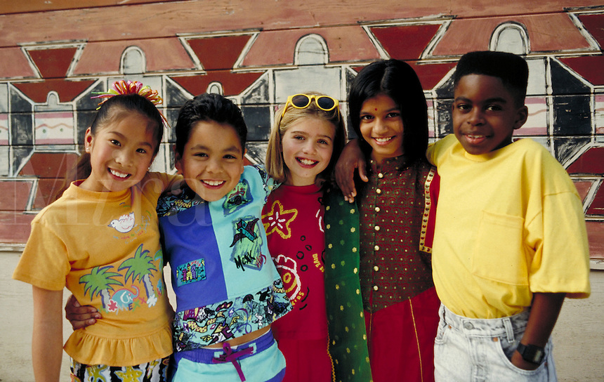 DIVERSE GROUP OF CHILDREN STANDING TOGETHER. OAKLAND CALIFORNIA USA.